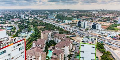 High view point cityscape of Accra, Ghana. Traffic jam on George